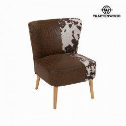 Fauteuil en tissu motif vache by Craften Wood
